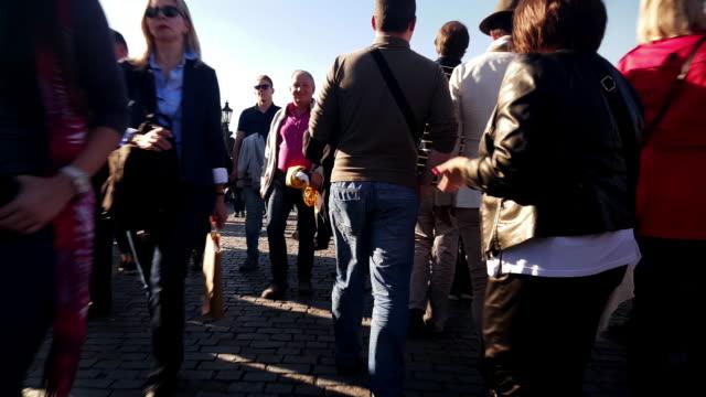 walking among charles bridge tourists in prag - charles bridge stock videos & royalty-free footage