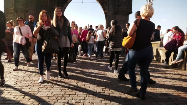 walking among charles bridge tourists in prag - old town bridge tower stock videos and b-roll footage