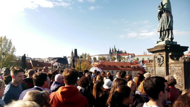 walking among charles bridge tourists in prag - hradcany castle stock videos and b-roll footage