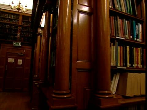 pov, walking around library at night - moulding trim stock videos & royalty-free footage
