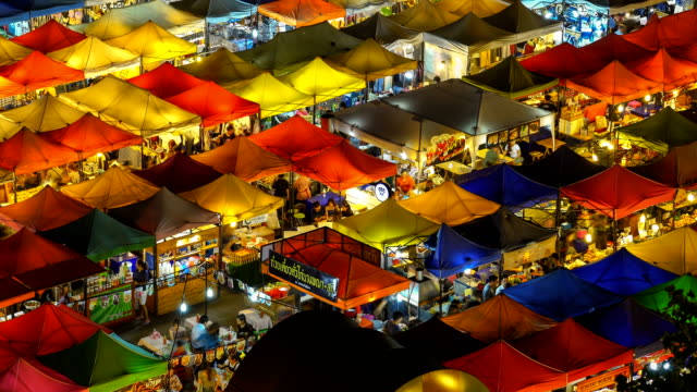 walking at night market - tent stock videos and b-roll footage