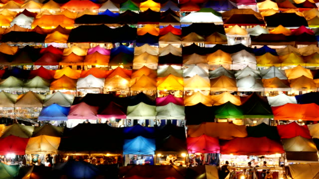 walking at night market - buy single word stock videos & royalty-free footage