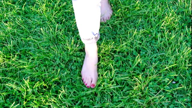 walking barefoot in the park. - barefoot stock videos & royalty-free footage