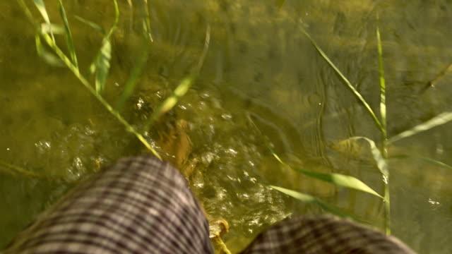Walking barefoot in water of lake
