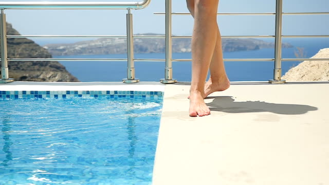 walking barefoot on the poolside - decking stock videos & royalty-free footage