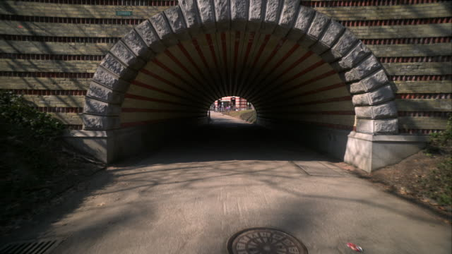 Walking beneath Playmates Arch in Central Park in New York City