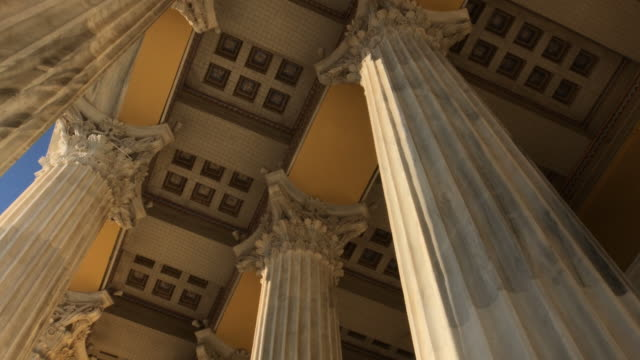 pov, walking between columns of zappeion, low angle view - low angle view video stock e b–roll