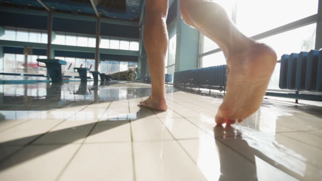 walking by poolside - tile stock videos & royalty-free footage