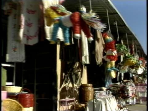 POV of Walking By Tijuana Street Stands Selling Tchotchkes
