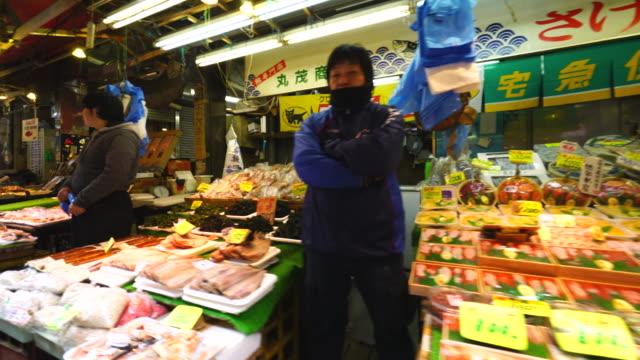 Walking camera captures Fresh Seafood Shops at Ameyoko Shopping Street in Ueno, Taito-ku Tokyo.