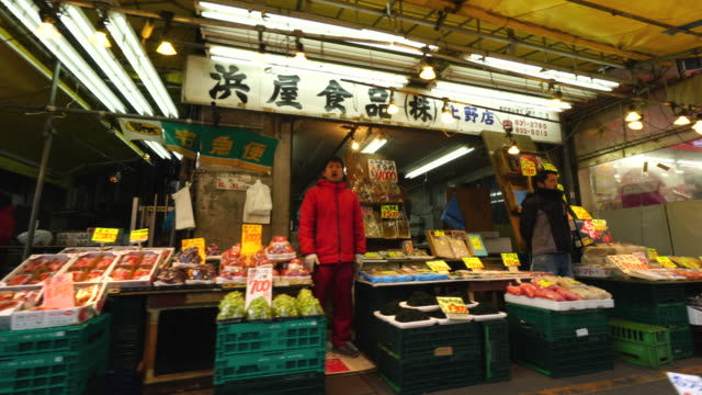 walking camera captures fruit and vegetable shop at ameyoko shopping street in ueno, taito-ku tokyo. - greengrocer's shop stock videos & royalty-free footage