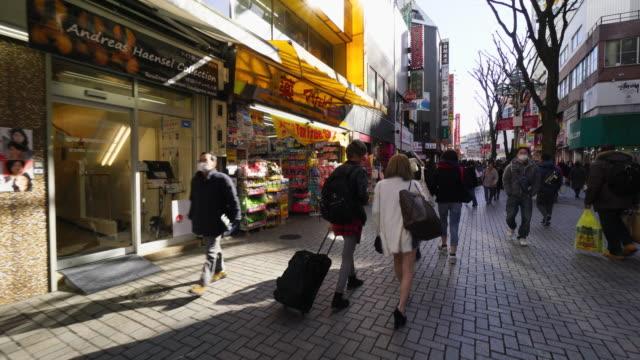 Walking camera captures intersection at Yasukuni-Doori and goes through the Moa 2-Bangai Street and captures many shops and restaurant along the street in Shinjuku Tokyo.