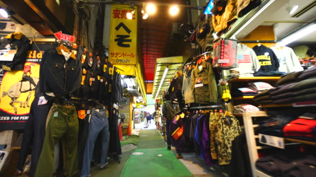 walking camera captures wide variety shops along the both side of ameyoko welcome mall, which are clothing, personal ornaments, shoes, cosmetics, bag, healthy goods, and more at in ueno, taito-ku tokyo. - clothes shop stock videos and b-roll footage