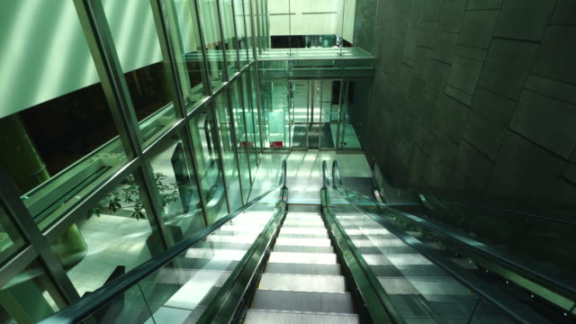 walking camera goes down the escalator and captures the shopping mall in basement area in roppongi district at akasaka, minato-ku tokyo. - tokyo midtown stock videos & royalty-free footage