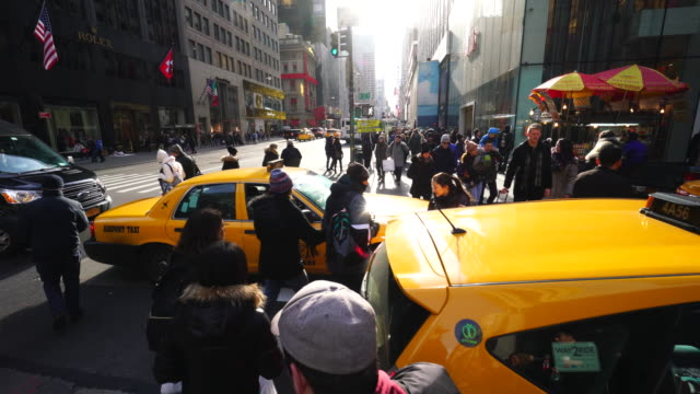 Walking camera goes through between the stuck taxis in traffic congestion of 5th Avenue Midtown Manhattan at Winter Holidays 2016.