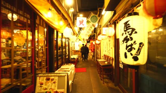 Walking camera goes through from Shinbashi side to Yurakucho side, which captures many Izakaya and Nomiya (Restarant Bar) along the both side of Bunka-Yokocho Alley in Yurakucho Sanchoku Inshokugai, Tokyo.