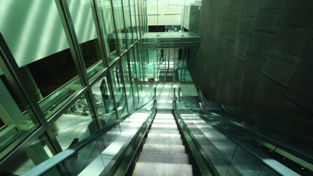 walking camera goes through the shopping mall in basement area and goes up the escalator to go outside of tokyo midtown in roppongi district at akasaka, minato-ku tokyo. - roppongi stock videos and b-roll footage