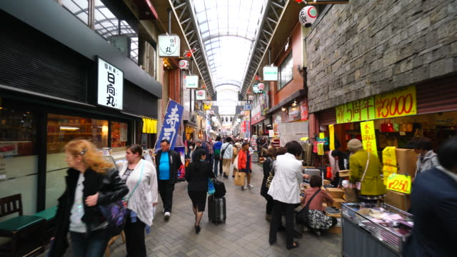 tl walking camera is going through the shin-nakamise shopping street, which crosses the nakamise-dori. camera captures many shops and restaurants along the both side of shopping arcade street. - randoseru stock videos & royalty-free footage