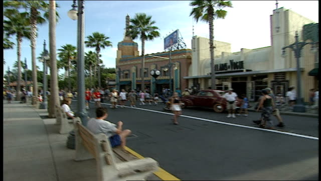 pov of walking down sidewalk in disney world - orlando florida stock videos & royalty-free footage
