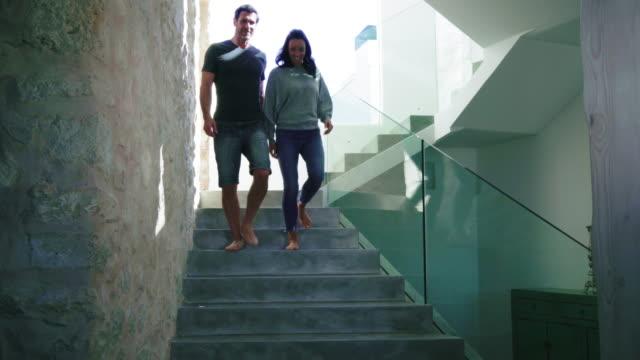 walking down stairs - barfuß stock-videos und b-roll-filmmaterial