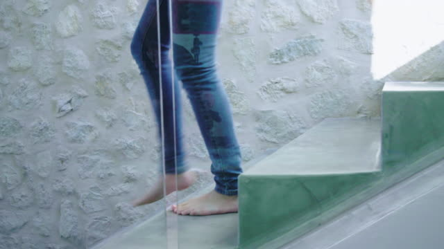 walking down stairs - barefoot stock-videos und b-roll-filmmaterial
