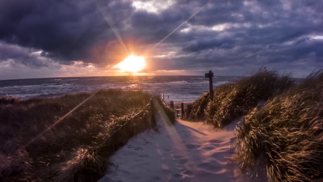 walking down to the ocean during a windy sunset - twilight stock videos & royalty-free footage