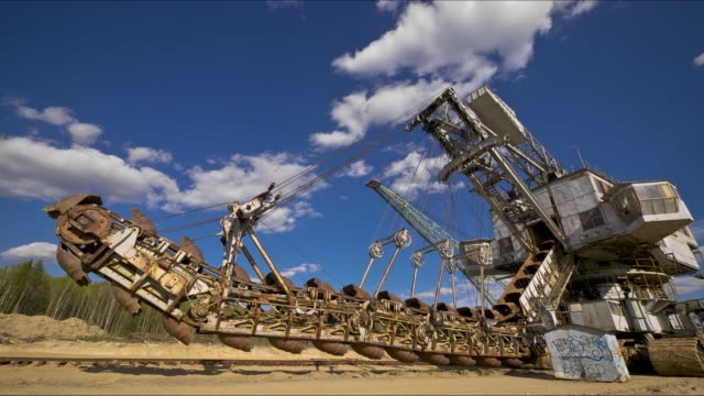 walking excavator in the sand mine - diesel fuel stock videos and b-roll footage