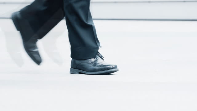 walking. fast pace and slow in the city. - dress shoe stock videos & royalty-free footage