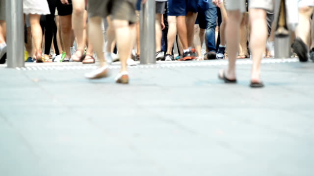 walking feet in crowded city street of singapore - human leg stock videos & royalty-free footage