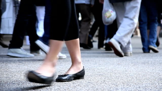 walking feet on a busy city street with audio - incidental people stock videos & royalty-free footage
