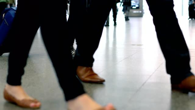 Walking Feet on a Busy train station, London, UK