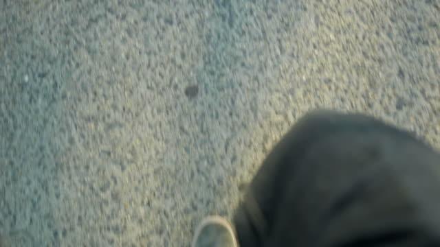 Walking feet on sidewalk slow motion
