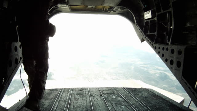 walking from the front to the back of a ch-47 chinook helicopter. - luftwaffe stock-videos und b-roll-filmmaterial