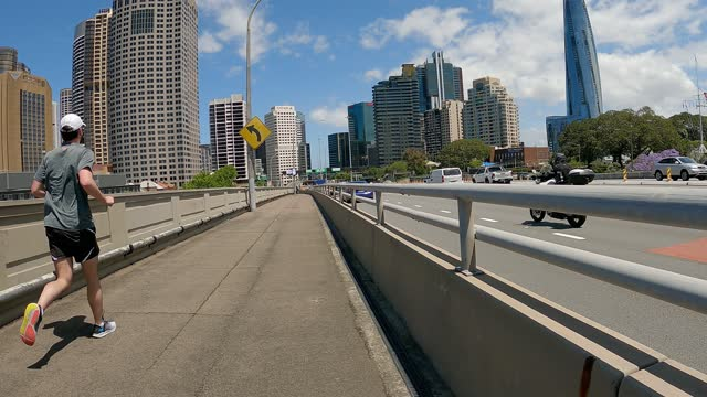 walking from the sydney harbour bridge towards the city, sydney cbd - railing stock videos & royalty-free footage