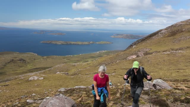 walking group on ben mor coigach, looking towards the summer isles, near ullapool, scotland, uk. - ridge stock videos & royalty-free footage