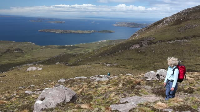 a walking group on ben mor coigach looking towards the summer isles near ullapool scotland uk - rough stock videos & royalty-free footage