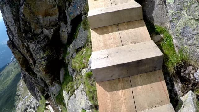 walking hiking climbing moving up a mountain, aletsch glacier, swiss alps, switzerland - elevated walkway stock videos & royalty-free footage