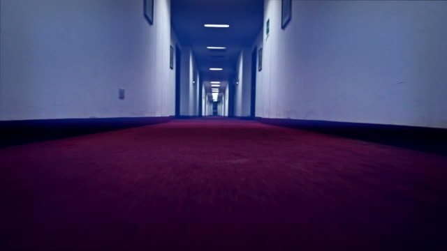 walking in a creepy hotel corridor - motel stock videos and b-roll footage