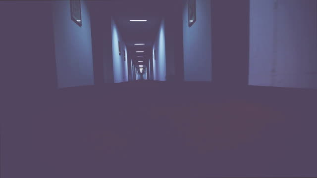 walking in a creepy hotel corridor - motel stock videos & royalty-free footage