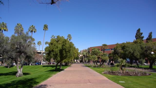 pov walking in asu tempe campus / tempe, az, usa - campus stock videos & royalty-free footage