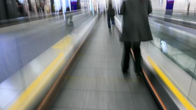 walking in international airport - hong kong international airport stock videos and b-roll footage