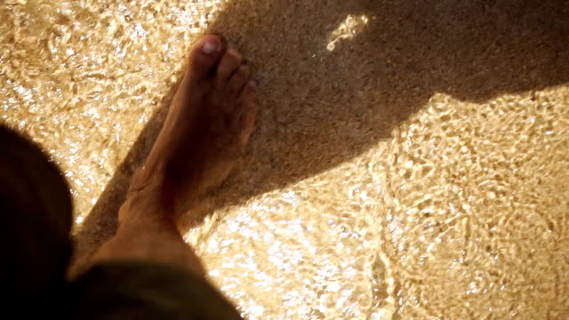 Walking in shallow sea water