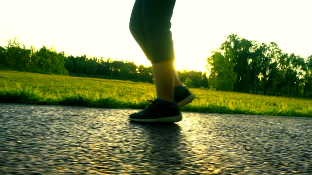 walking in sunlight - trainer stock videos & royalty-free footage