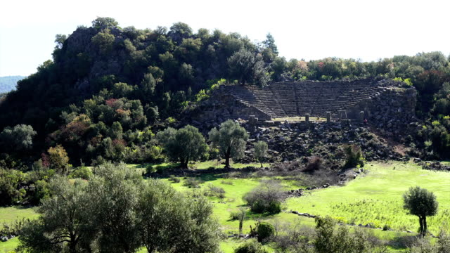 walking in the ancient city of pinara. pinara, fethiye, turkey. - mythology stock videos & royalty-free footage