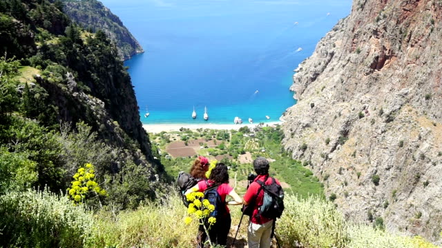 walking in the butterfly valley. - oludeniz stock videos and b-roll footage