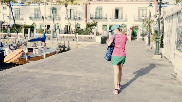 walking in the old town. female tourist on vacation - marina stock videos & royalty-free footage