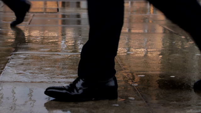 walking in the rain. city commuter's feet. - footpath stock videos & royalty-free footage