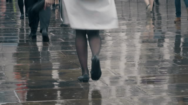 walking in the rain. time lapse of legs and feet. - urban road stock videos & royalty-free footage