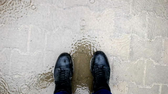 slow mot - walking in the rain - human foot stock videos & royalty-free footage