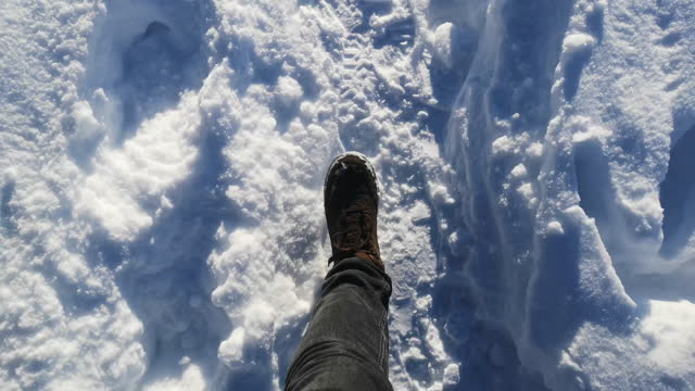 walking in the snow - stepping stock videos & royalty-free footage